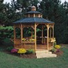 12-ft. Round Seaside Gazebo shown with optional floor, two-tier roof, cupola, flowerboxes and bench/table.